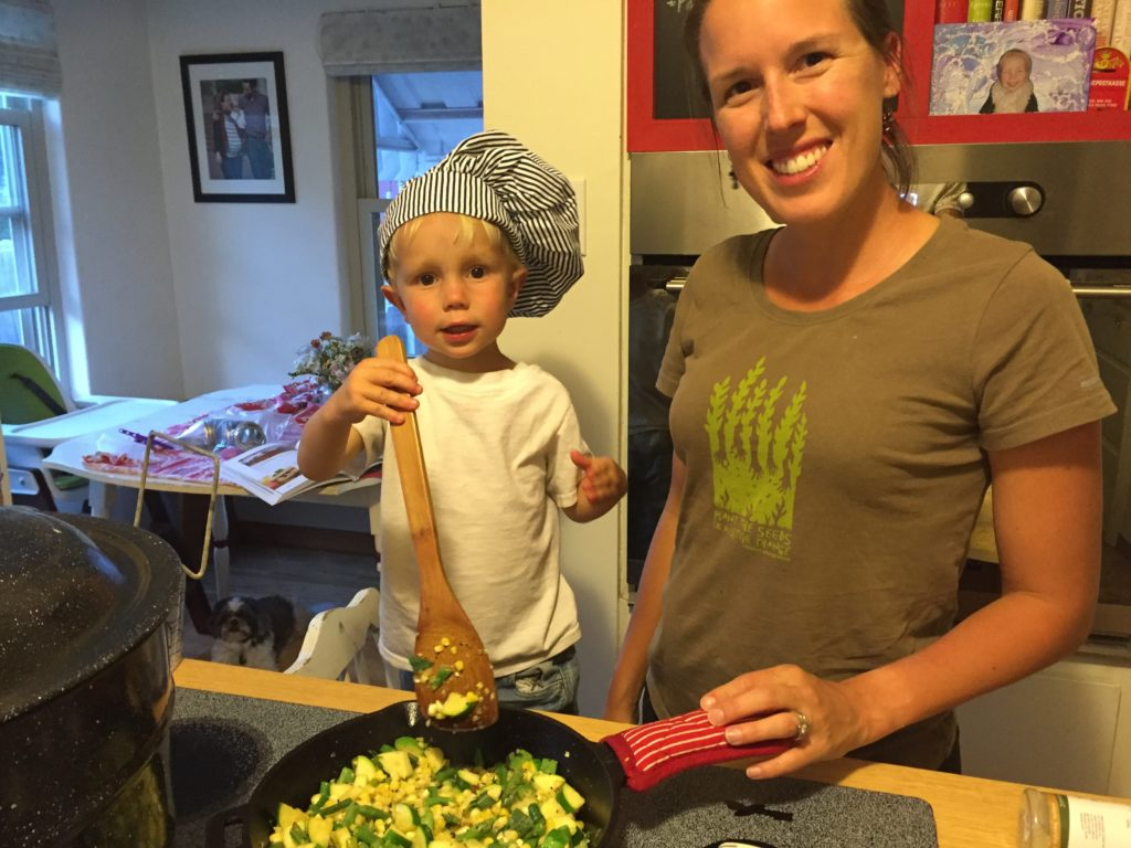 Mom and son cooking together